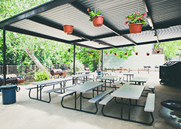 Covered Patio overlooking the Comal River with community BBQ pit.