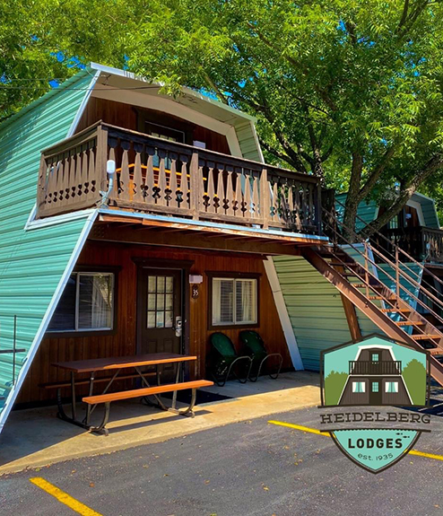 Heidelberg Lodges A-Frame Cottages located on the banks of the Comal River.